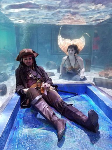 Real life mermaid at SeaQuest with Captain Quest, the beloved pirate.